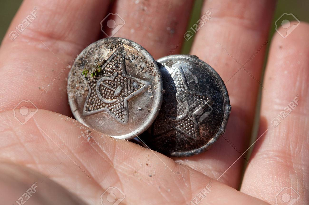 Old military buttons with sovietic symbols - the hammer and sickle