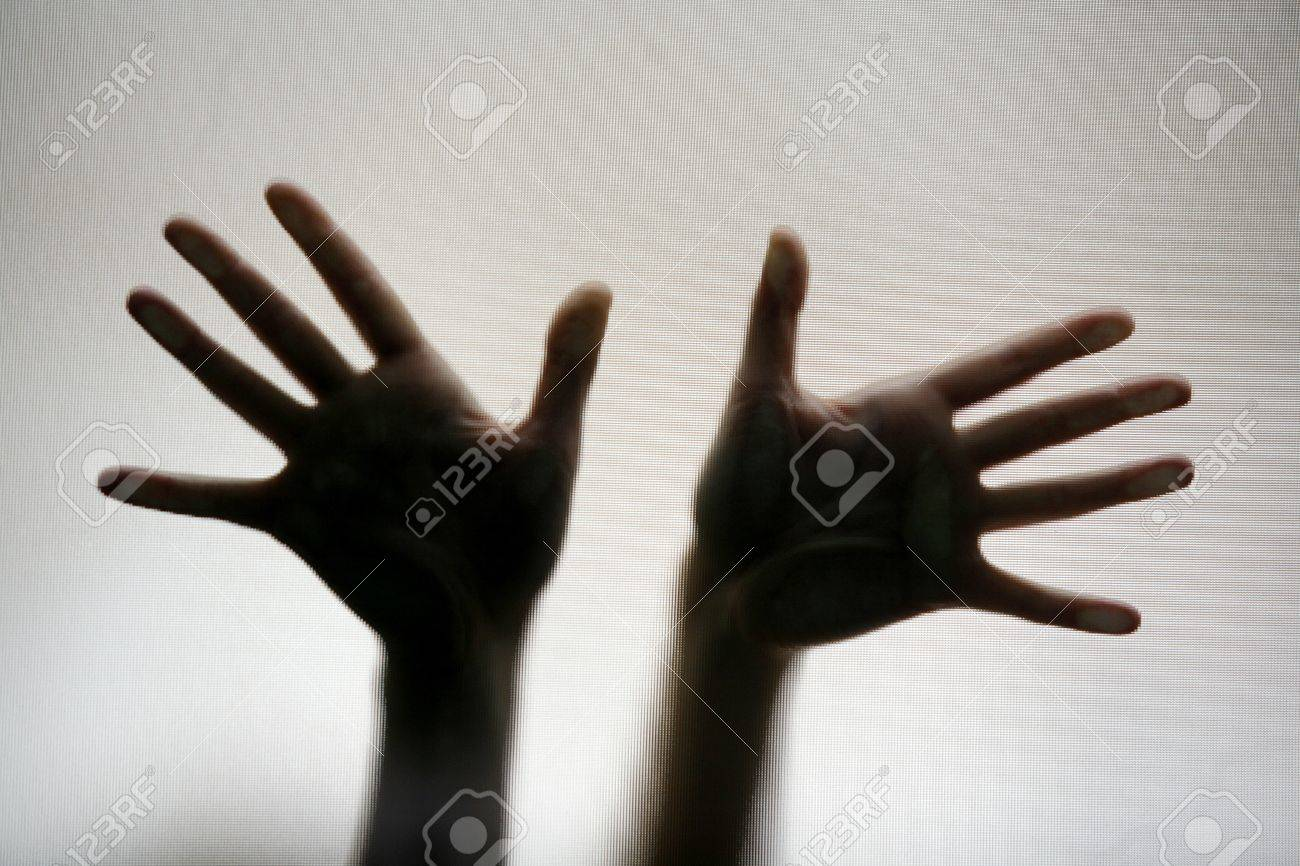 Two hands pressed against a diffused screen Stock Photo - 9385744