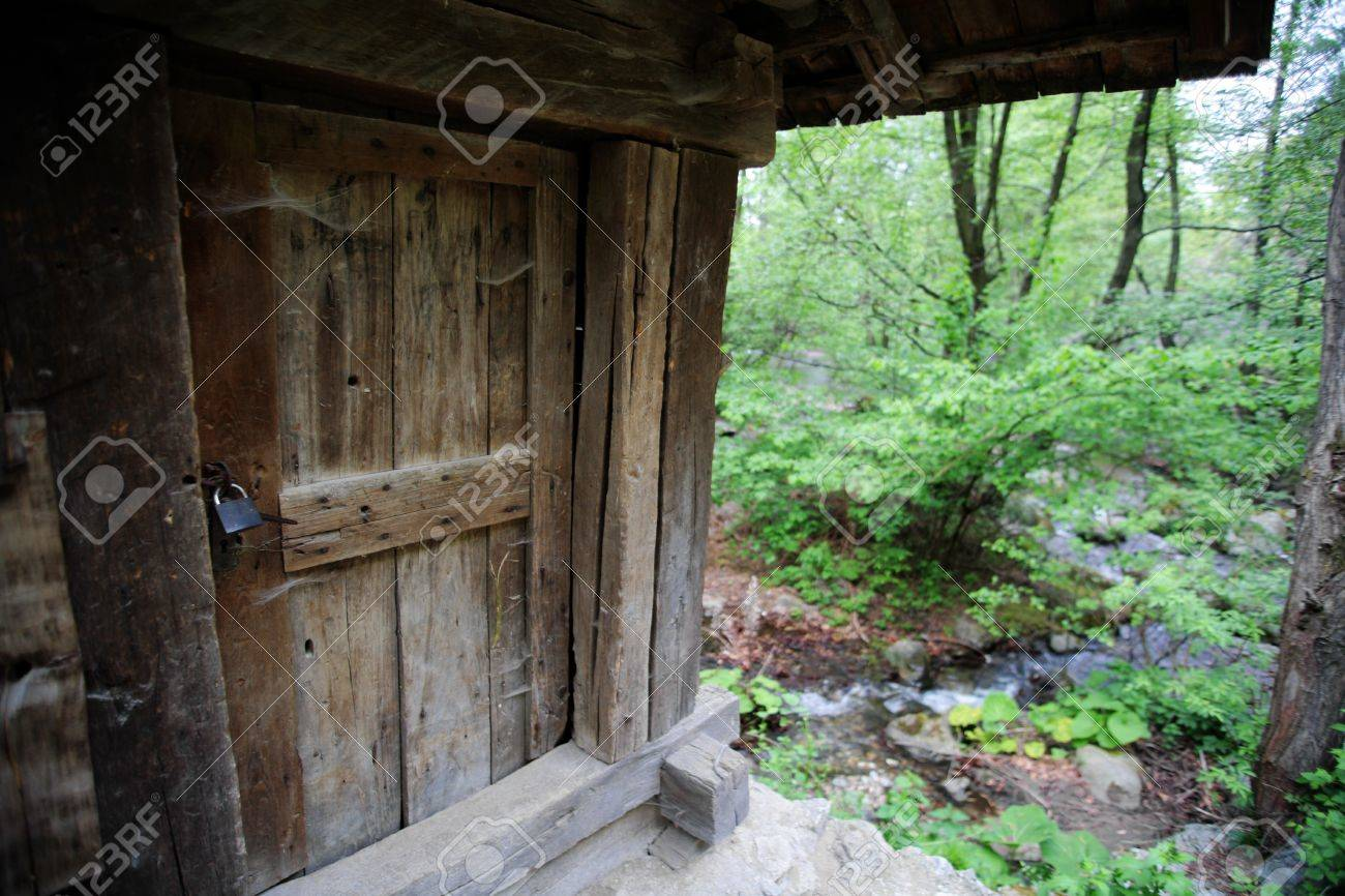 Old wooden door from a forest house stock photo 9714013