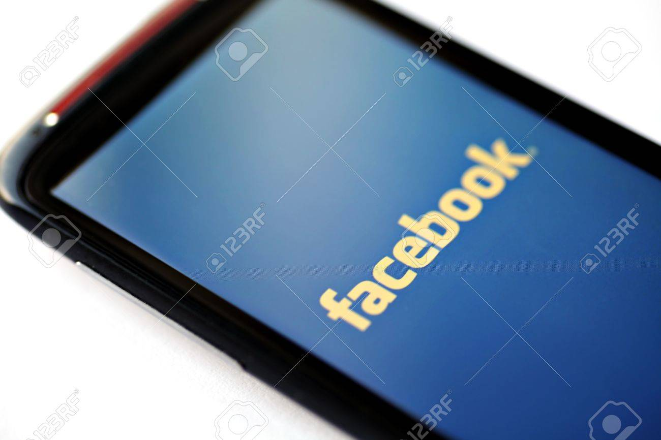 Bucharest, Romania - March 28, 2012: Facebook logo is displayed on a mobile phone screen. Facebook is a social networking service launched in February 2004, having more than 845 million active users. Stock Photo - 13455767