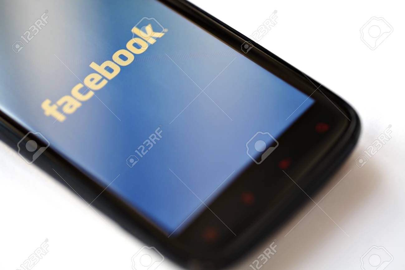 Bucharest, Romania - March 28, 2012: Facebook logo is displayed on a mobile phone screen. Facebook is a social networking service launched in February 2004, having more than 845 million active users. Stock Photo - 13574857