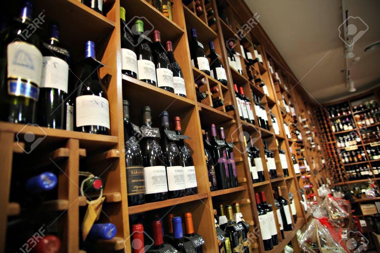 Bucharest, Romania - May 31, 2012: Wine bottles are displayed on shelves in a store in Bucharest, Romania.  Stock Photo - 14818683