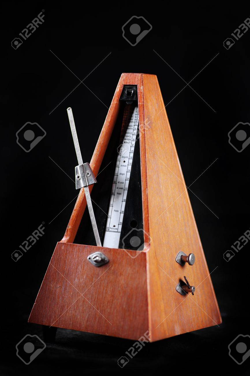 Vertical shot of a vintage metronome, on black Stock Photo - 14978356