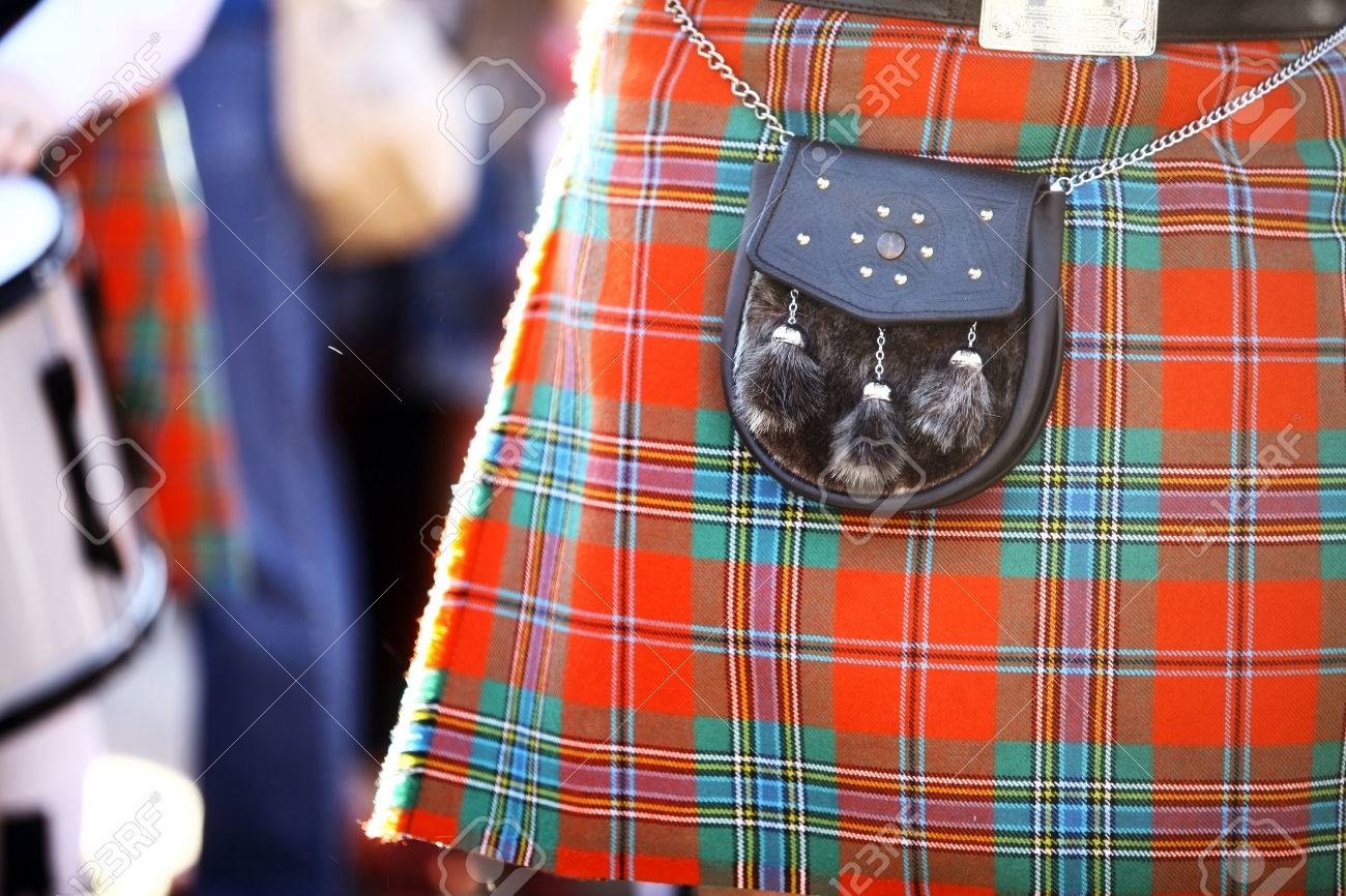 color detail of a traditional scottish kilt with a bag stock