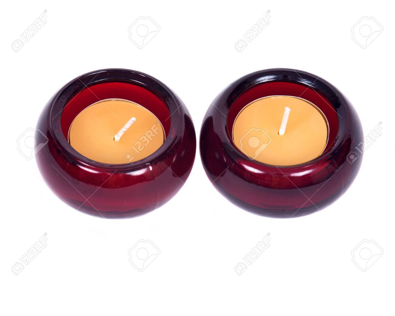 Stock photo two candles in decorative candleholders