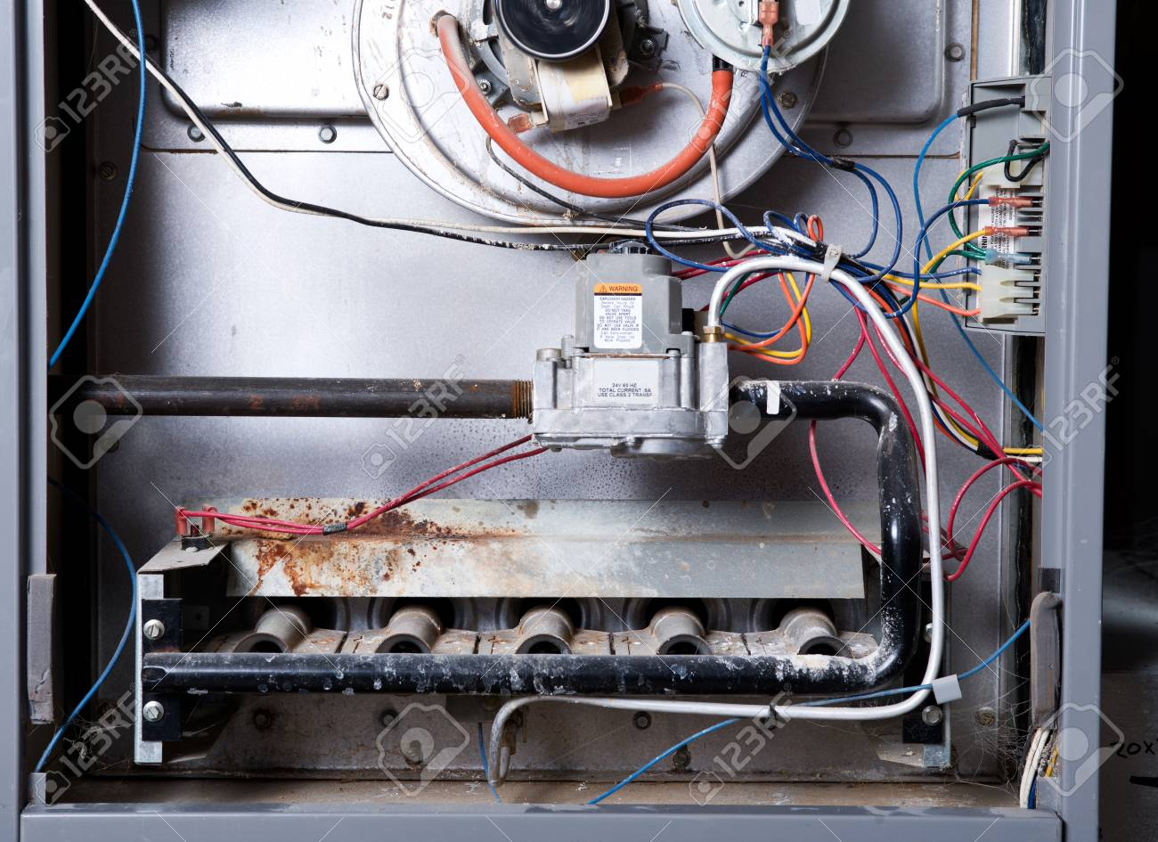 Open home furnace just ready for cleaning and repair - 97774587