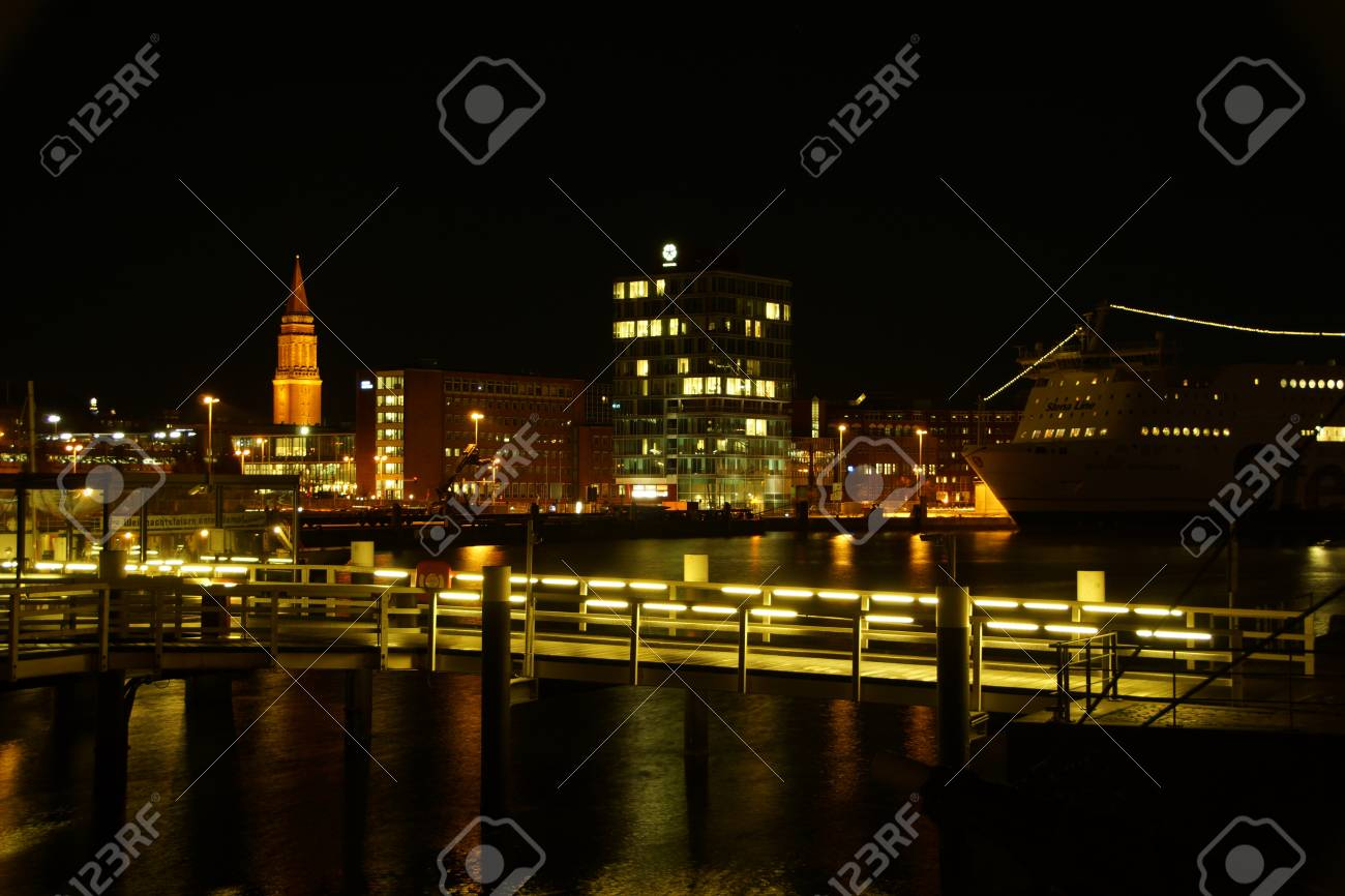 Kiel illuminated skyline at night with harbour and glowing sky Stock Photo - 17402607
