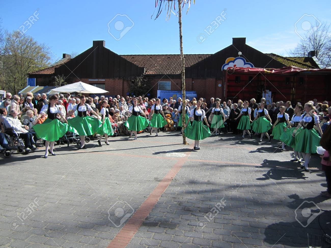 Dancing around the maypole Stock Photo - 24048097