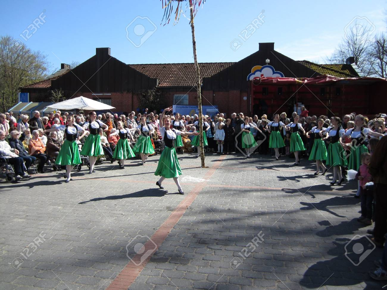 Dancing around the maypole Stock Photo - 24048098