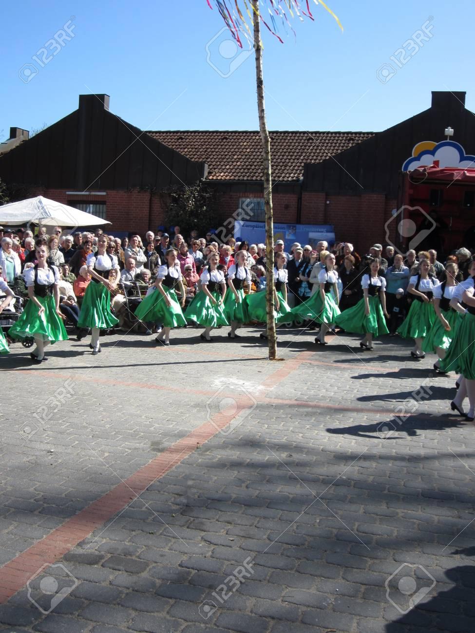 Dancing around the maypole Stock Photo - 24048105