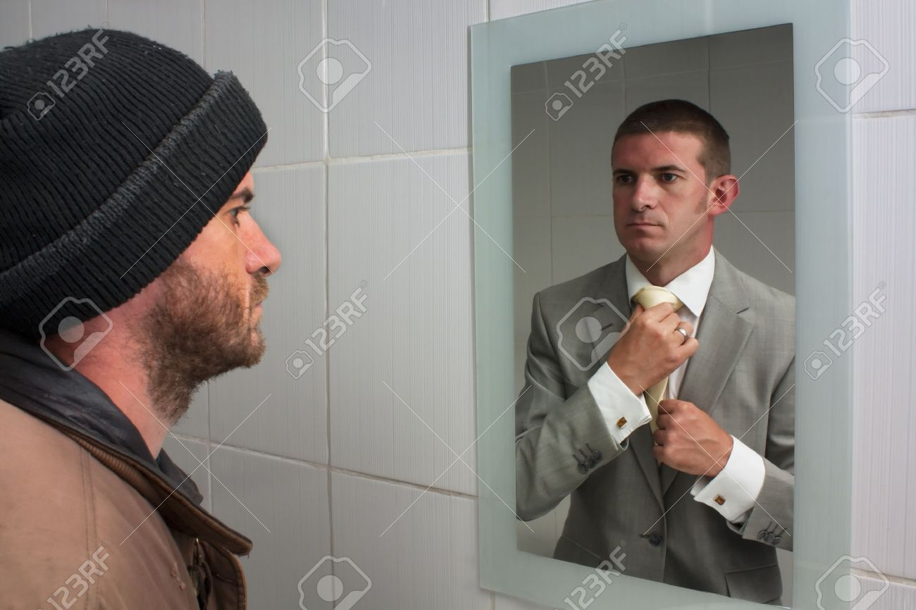 homelss man looking in mirror and seeing dreams of the future stock