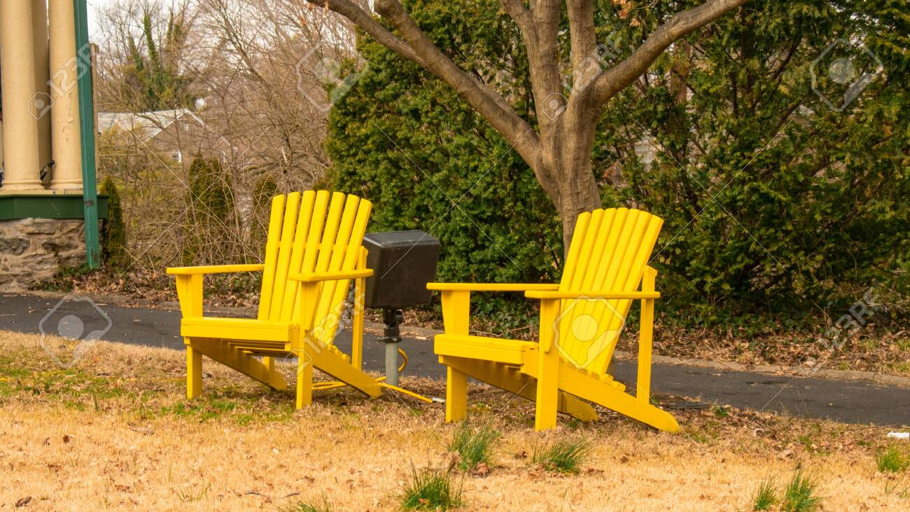 Picture of: Two Bright Yellow Wooden Lawn Chairs On A Dead Lawn With A Driveway Stock Photo Picture And Royalty Free Image Image 141190010