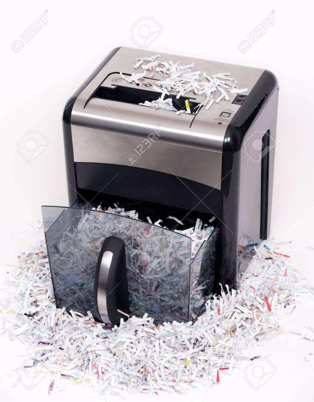 An open paper shredder with shredded paper all around Stock Photo - 4398550