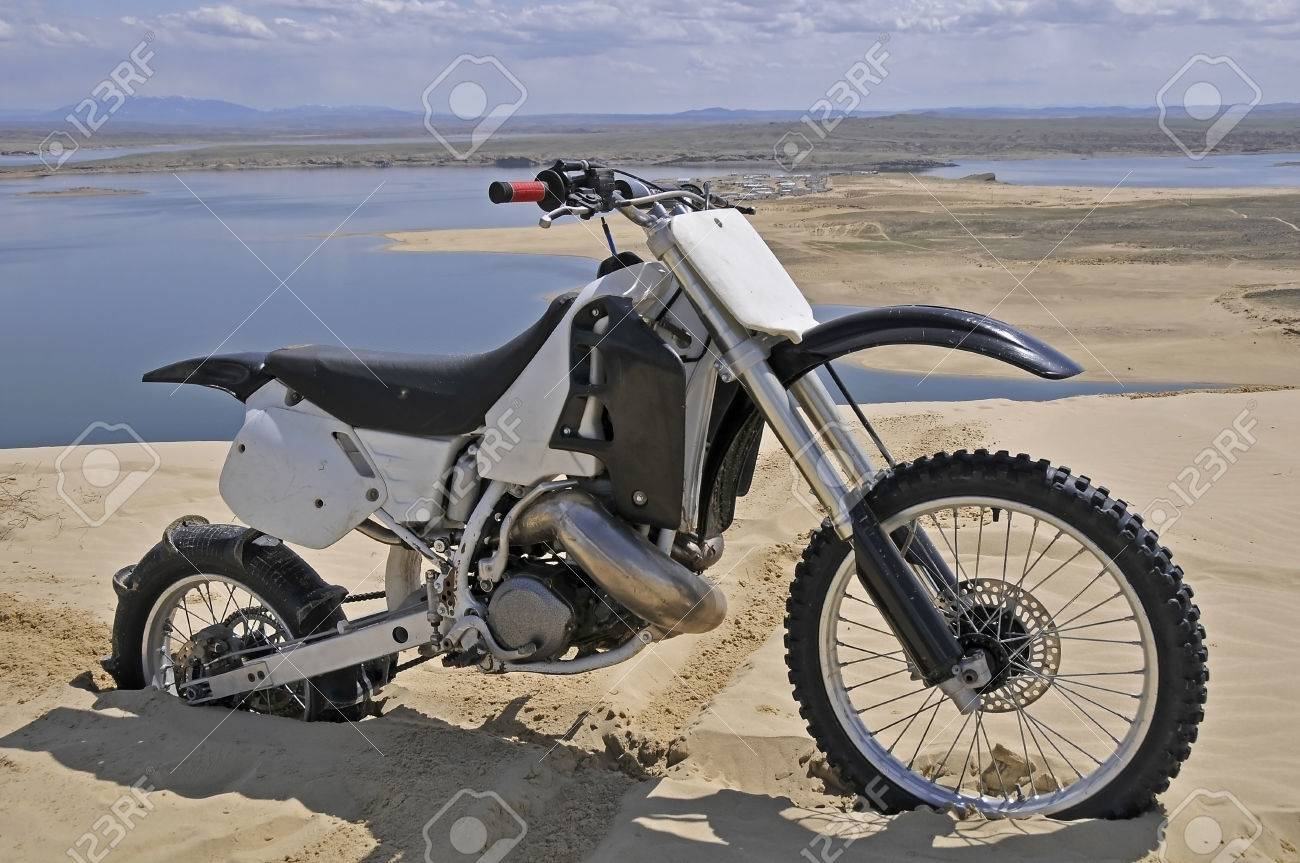 Dirt Bike With Paddle Tire Burried In Sand Dune Stock Photo