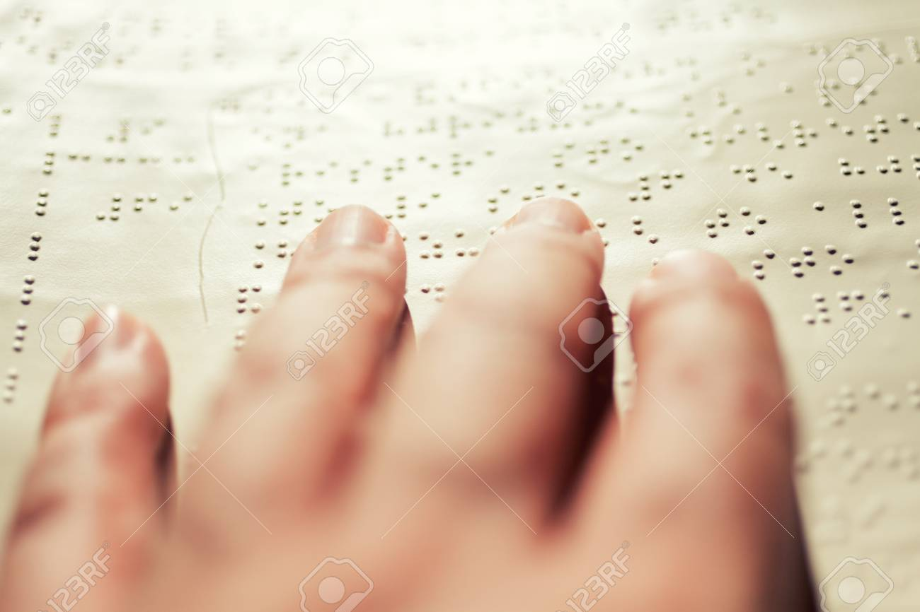 Close up of male hand reading braille text Stock Photo - 28027395