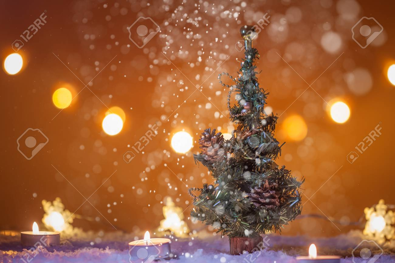 Snowing Christmas Tree.Chirstmas Background With Christmas Tree Snow Candles Lights