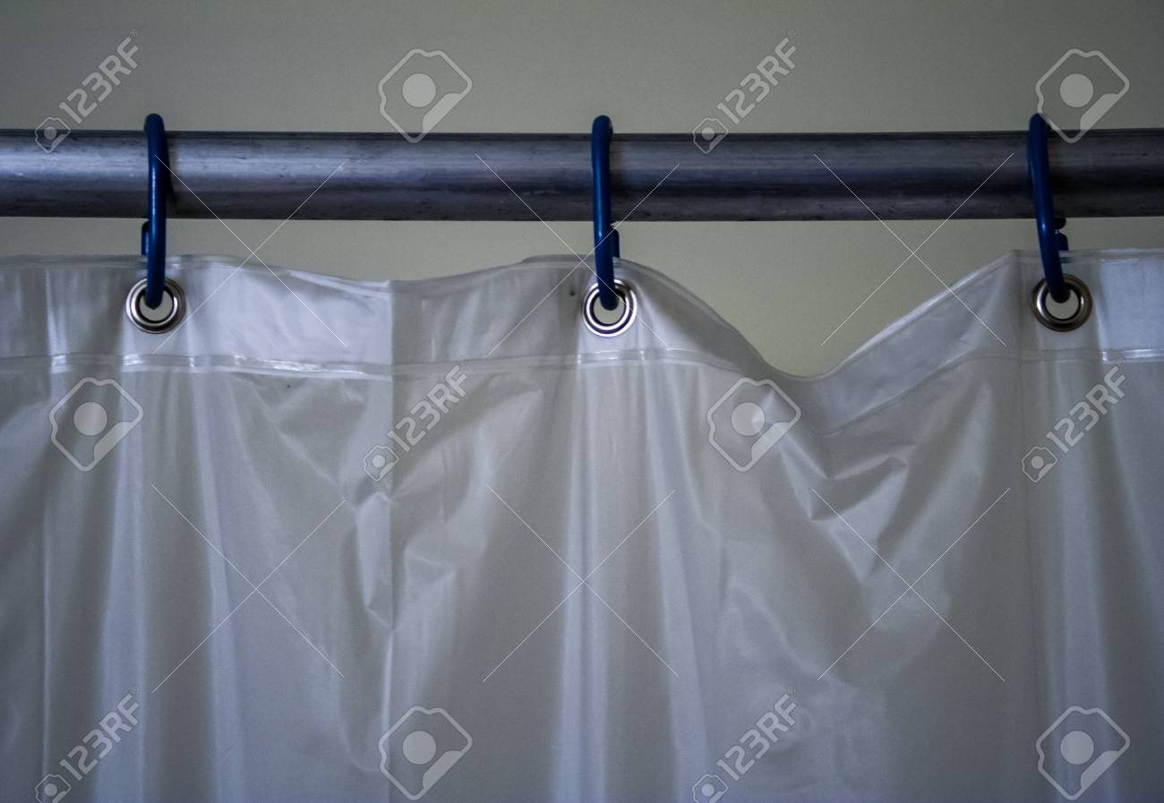 White Plastic Shower Curtain Three Rings Close Up Stock Photo
