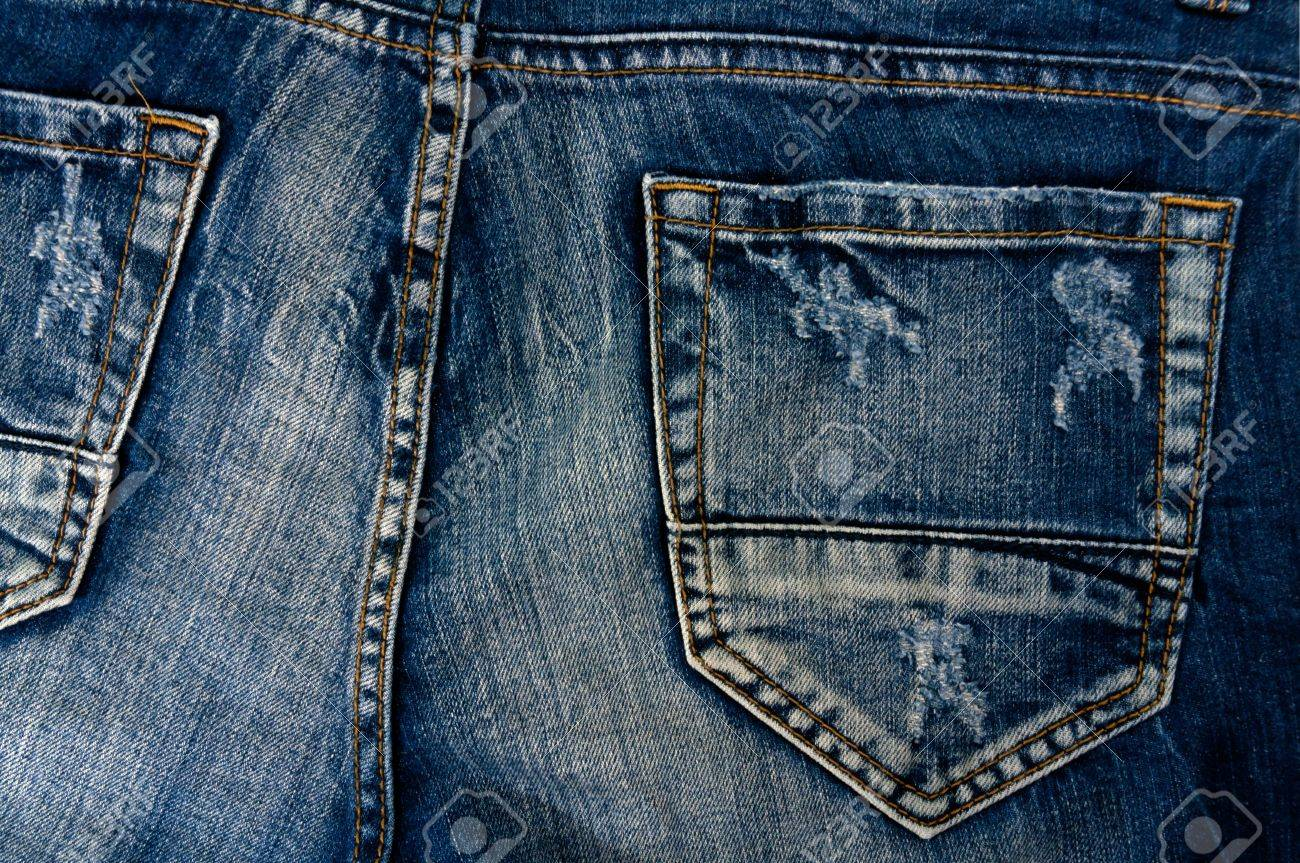Detail of torn Blue denim, front view  jean  background or texture Stock Photo - 13984401