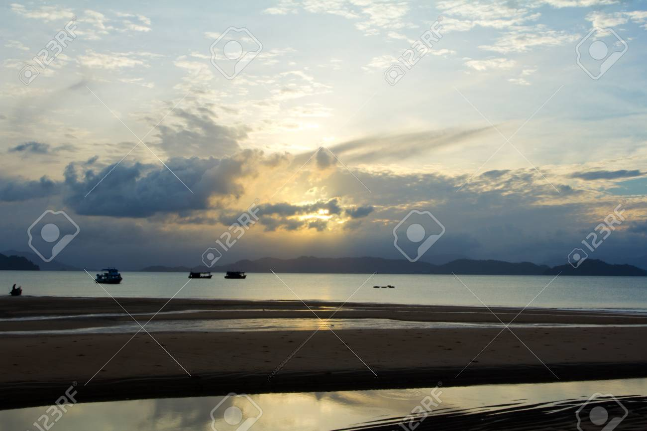 Tropical beach Sunset Sky With Lighted Clouds Stock Photo - 14795842