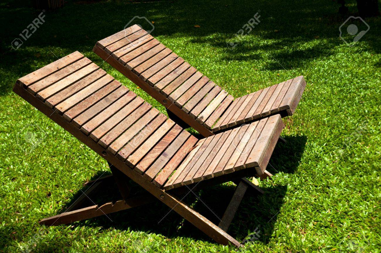 Picture of: Wooden Lawn Chairs In The Spring Garden Stock Photo Picture And Royalty Free Image Image 15115453