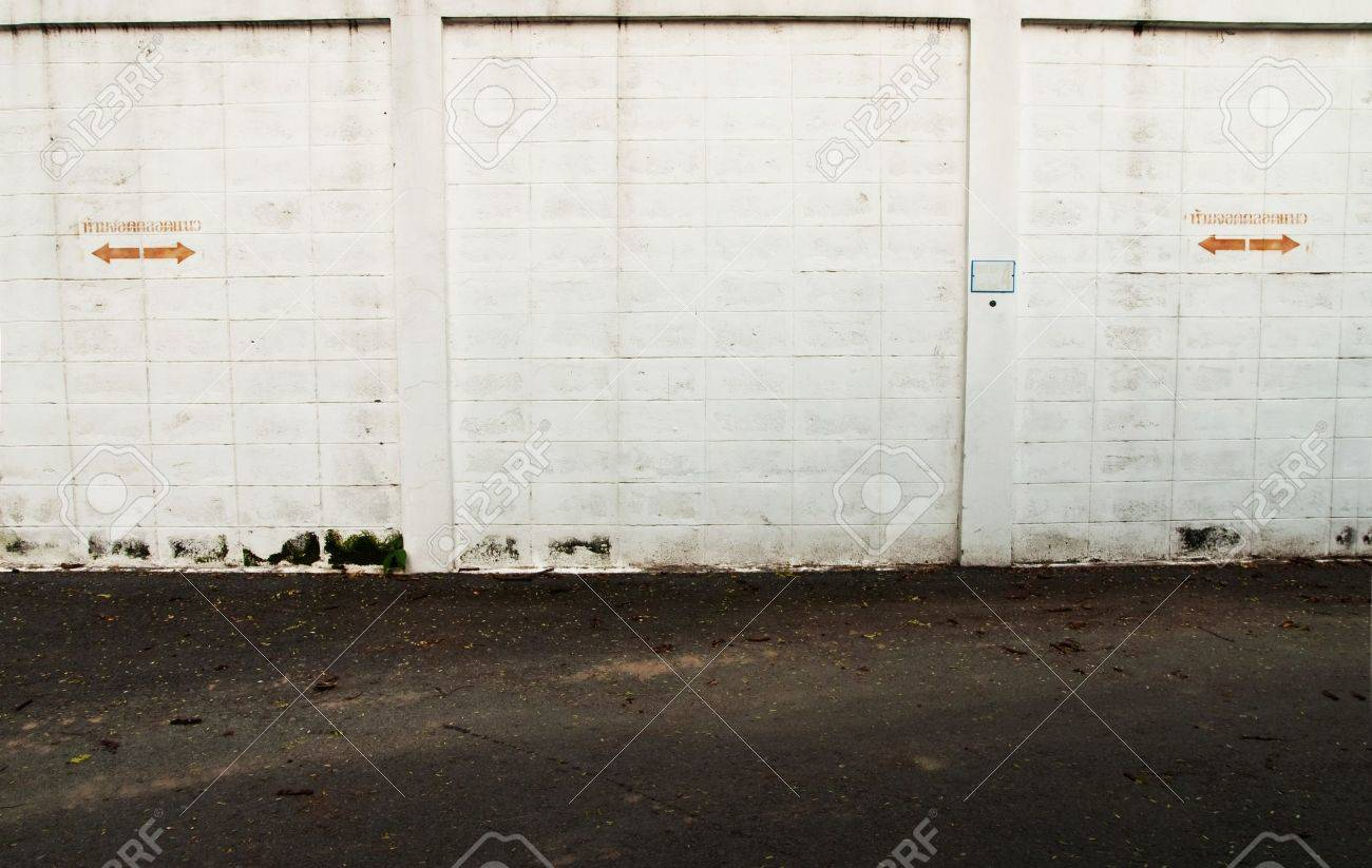 Grunge white wall in car park Stock Photo - 8274090