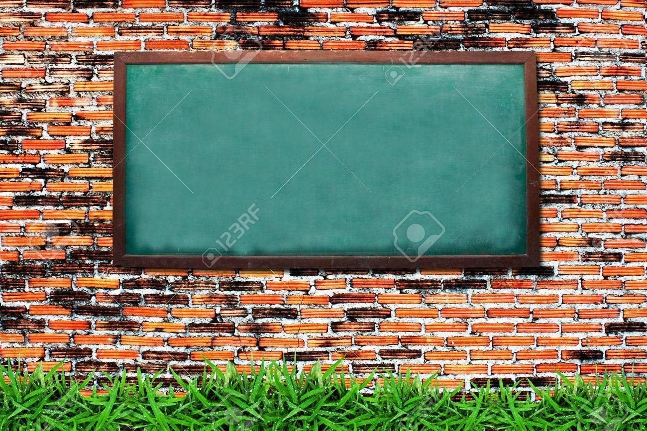 Chalkboard and green grass on grunge brick wall Stock Photo - 9742984