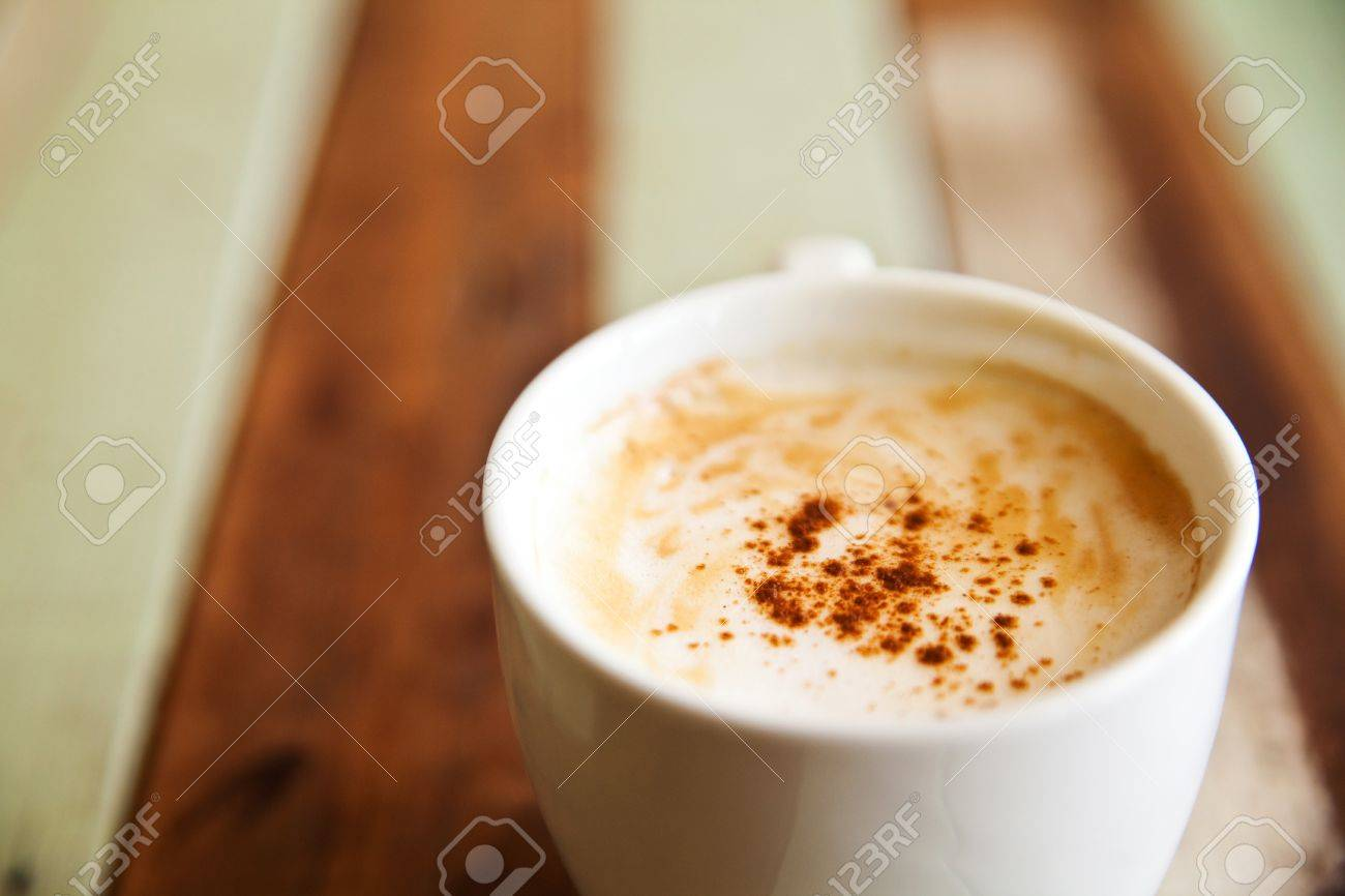Shallow dept of field, a cup of coffee on wood background Stock Photo - 14183930