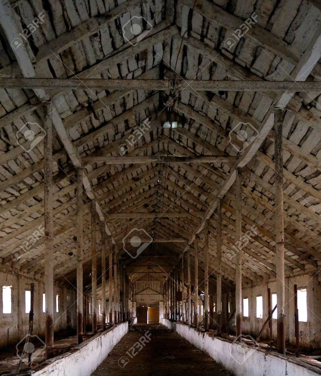 Interior Of Abandoned Barn With Beautiful Wooden Ceiling Stock Photo