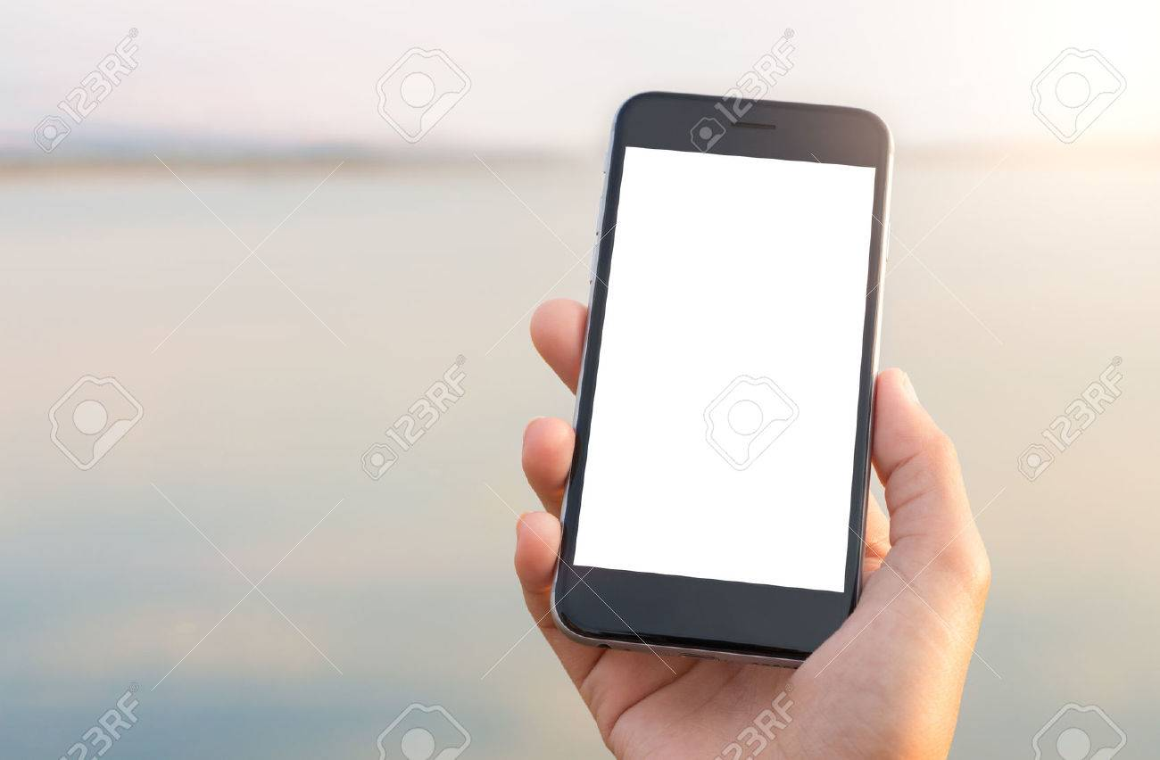 hand holing phone white screen at outdoor lifestyle - 56530820