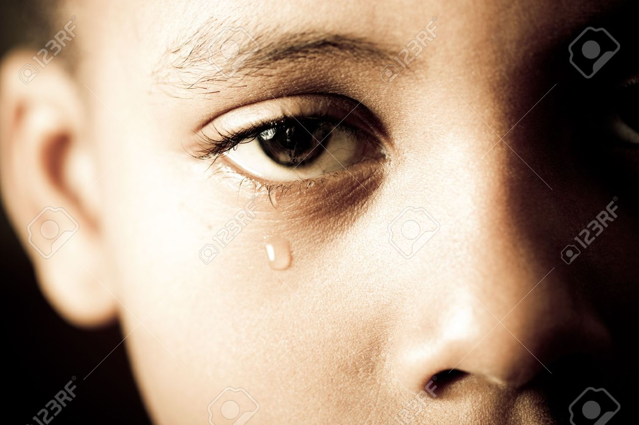 close up of a boy shedding a tear stock photo picture and royalty