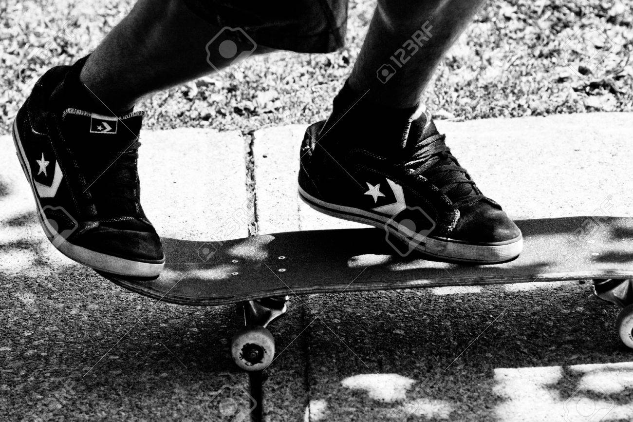 dfaad0ff471 Stock Photo - teen wearing converse skate shoes on skateboard ready for  action