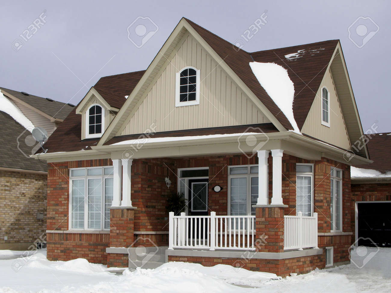 a small suburban house in winter stock photo picture and royalty