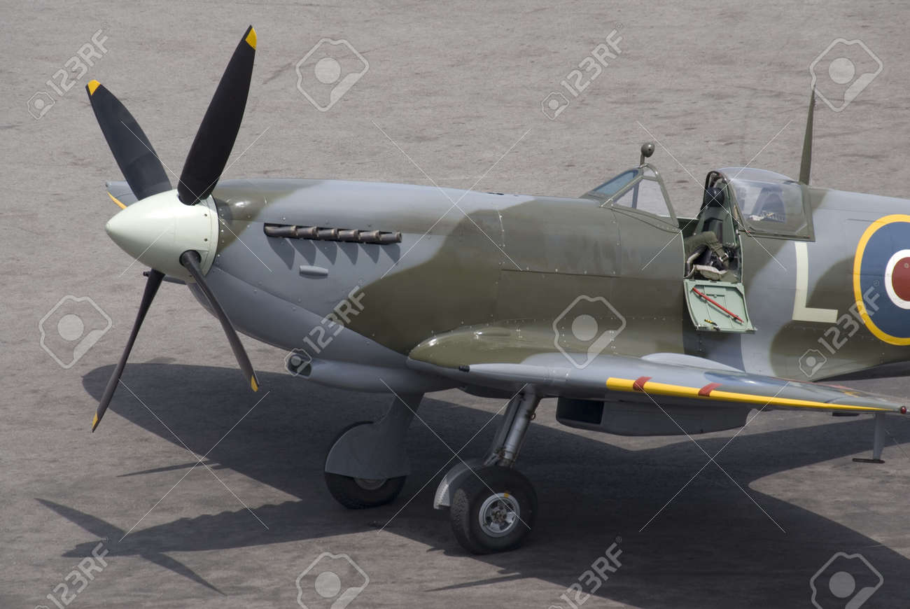 A British Spitfire fighter plane stands ready for action on an oil-stained airfield. Stock Photo - 1132221