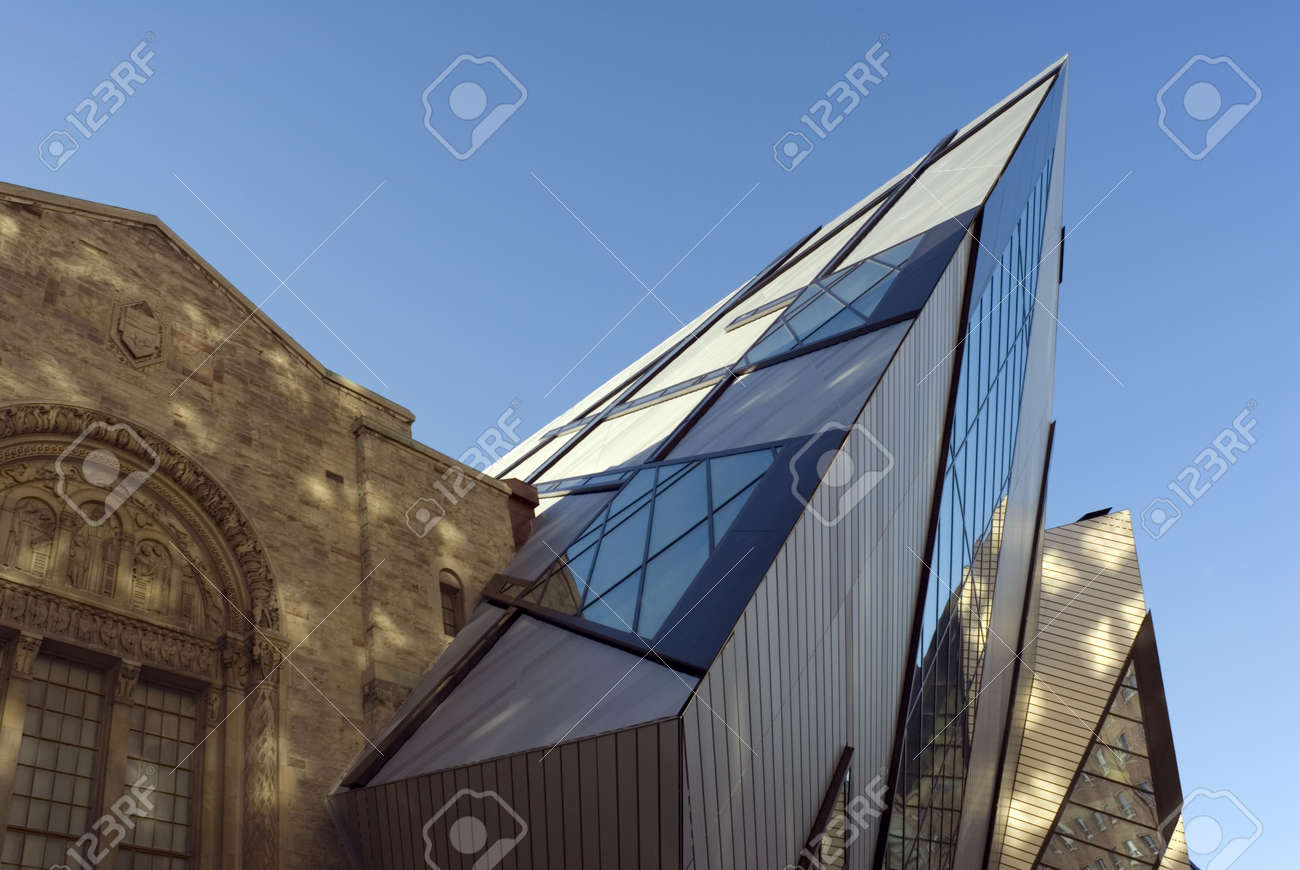 The north face of the Royal Ontario Museum in Toronto, Canada, showing part of the new Michael Lee-Chin Crystal extension designed by Daniel Libeskind, dappled by the earling morning sunlight. Stock Photo - 2413757