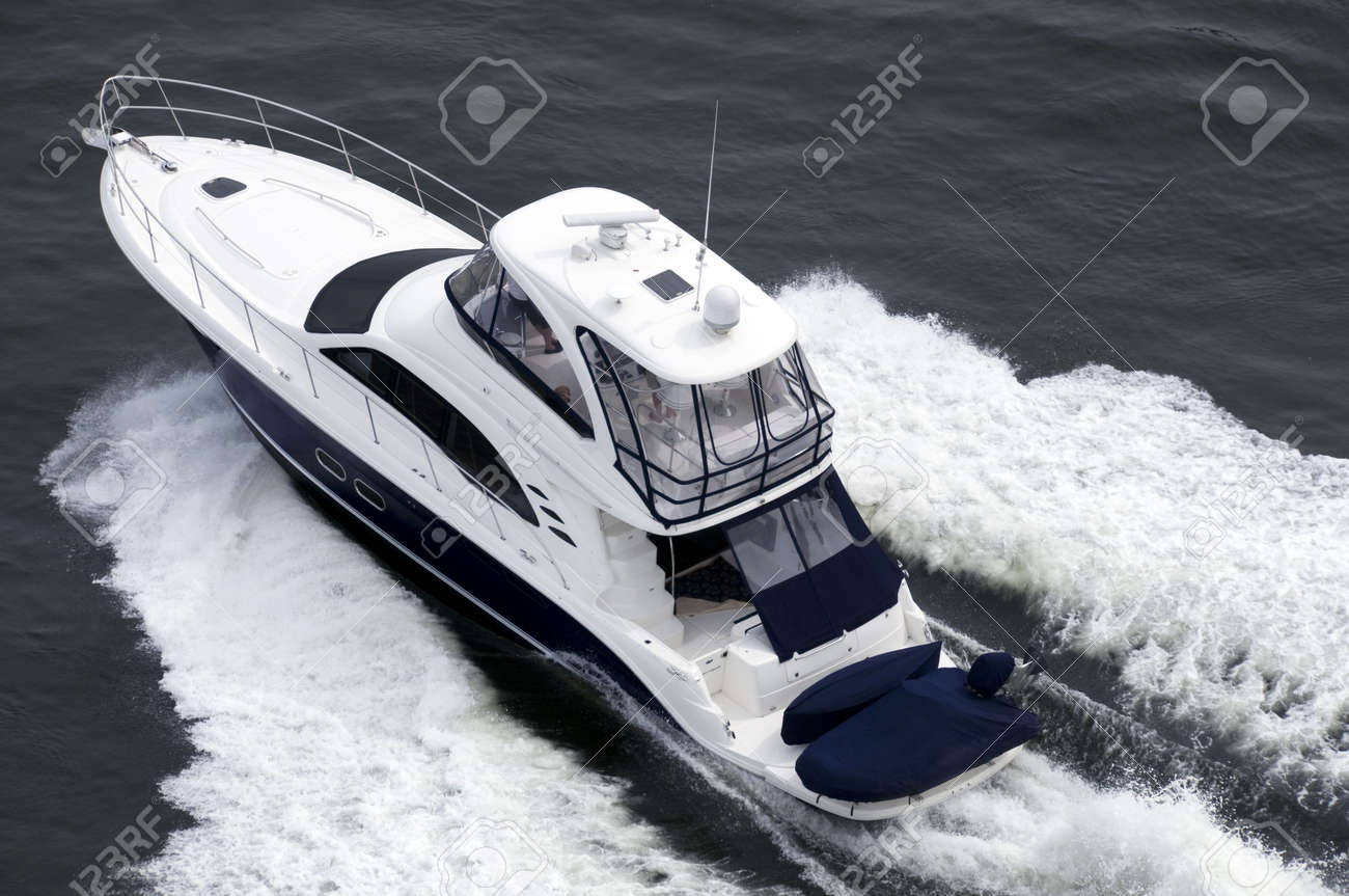 A blue and white speedboat shot from above while travelling fast. Stock Photo - 3009189