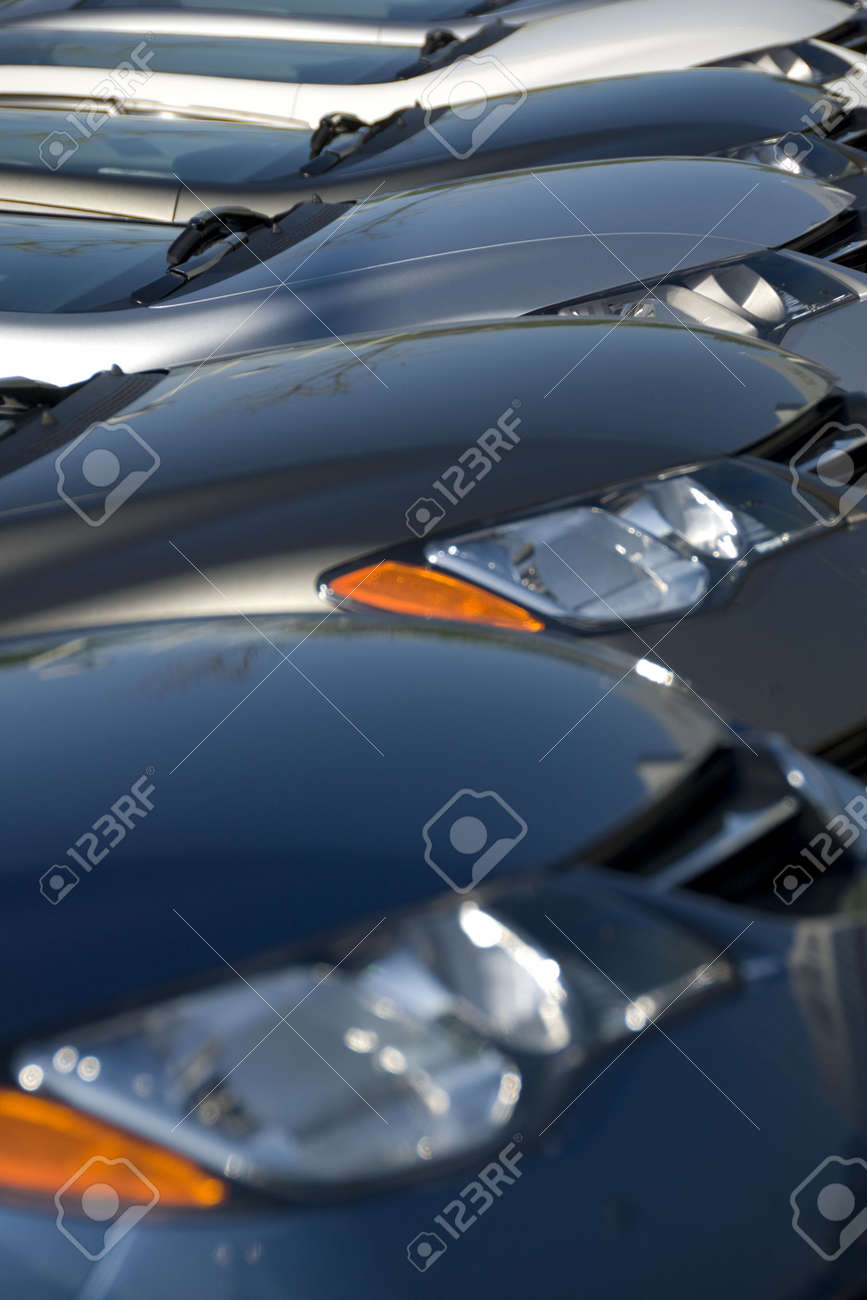 A lineup of new cars at a dealership. (Shot with minimum depth of field. Focus is on the third vehicle from the front.) Stock Photo - 3642884