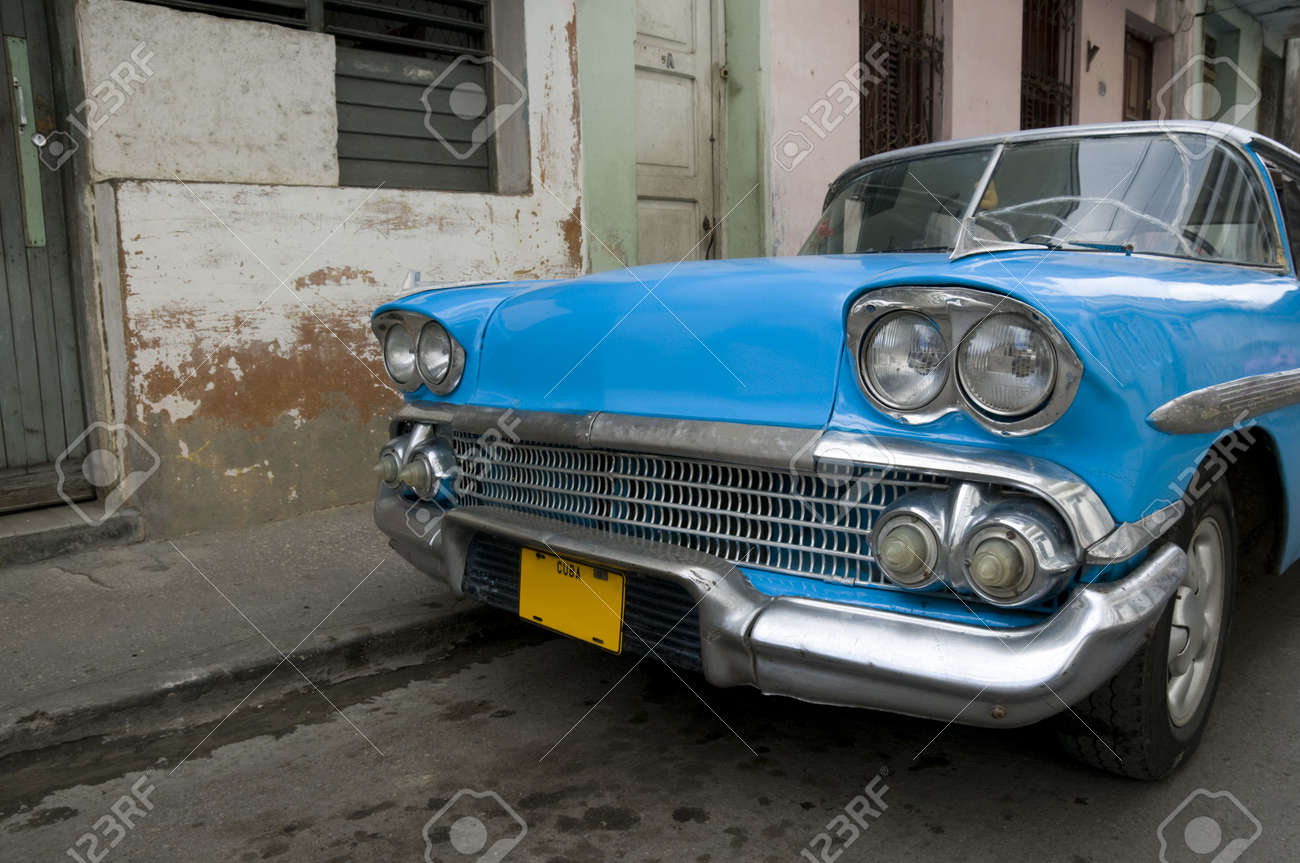 A bright blue 1950s American car still running on the streets of Cuba. Stock Photo - 4444238