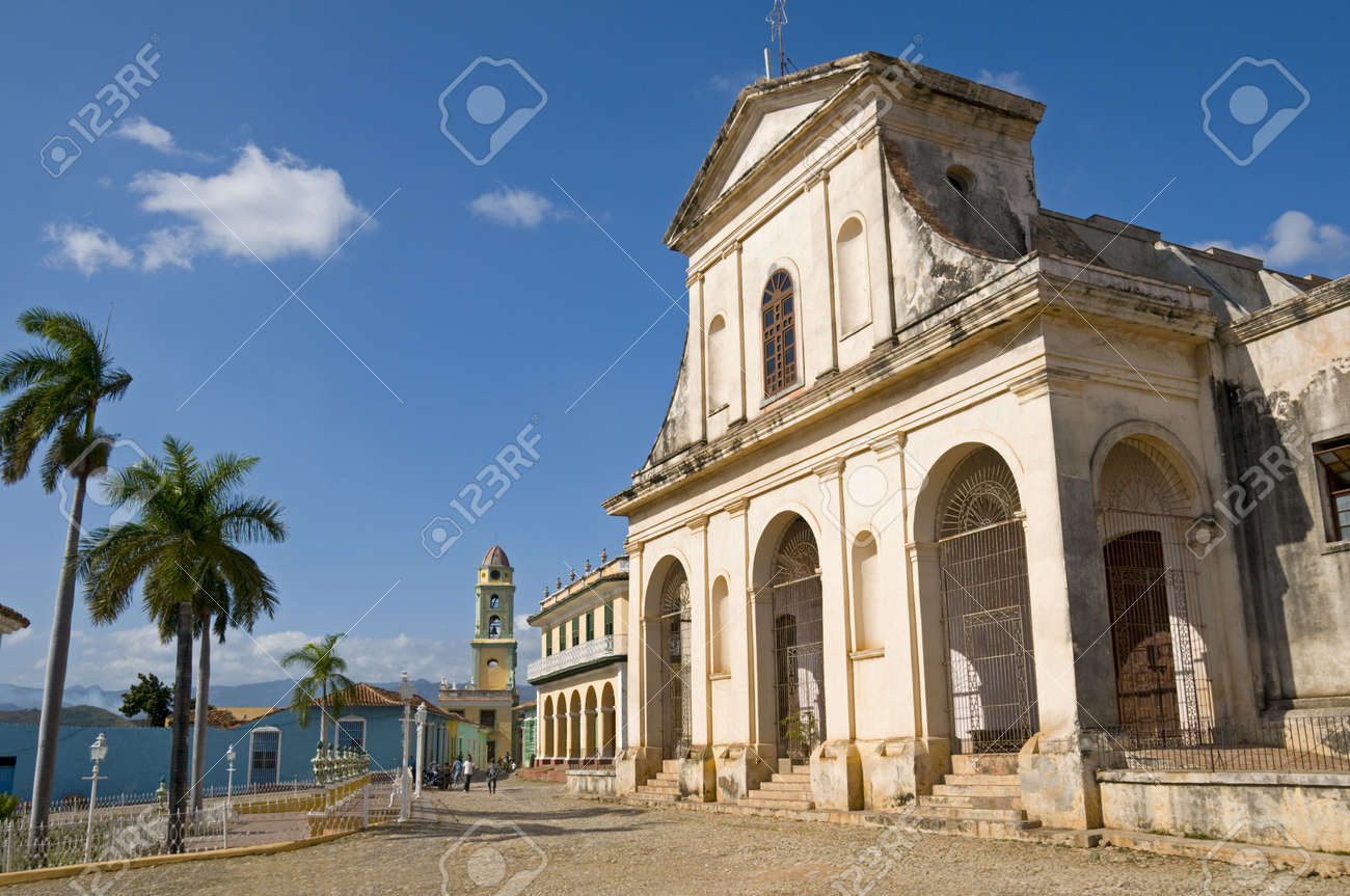 Santisima Trinidad Church in the central square of Trinidad, Cuba. The Romantico Museum is housed in the building immediately to its left. Stock Photo - 4444243