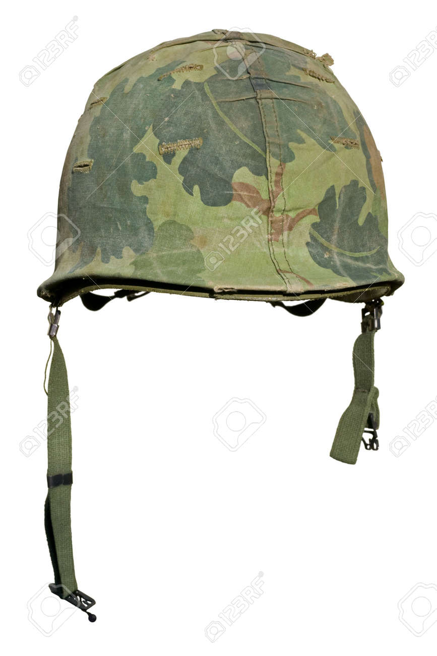 A US military helmet with an M1 Mitchell pattern camouflage cover from the Vietnam war. Stock Photo - 5673641