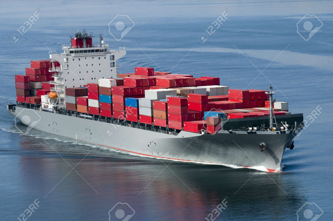 A container ship arriving in port on a very calm day. Stock Photo - 7110660