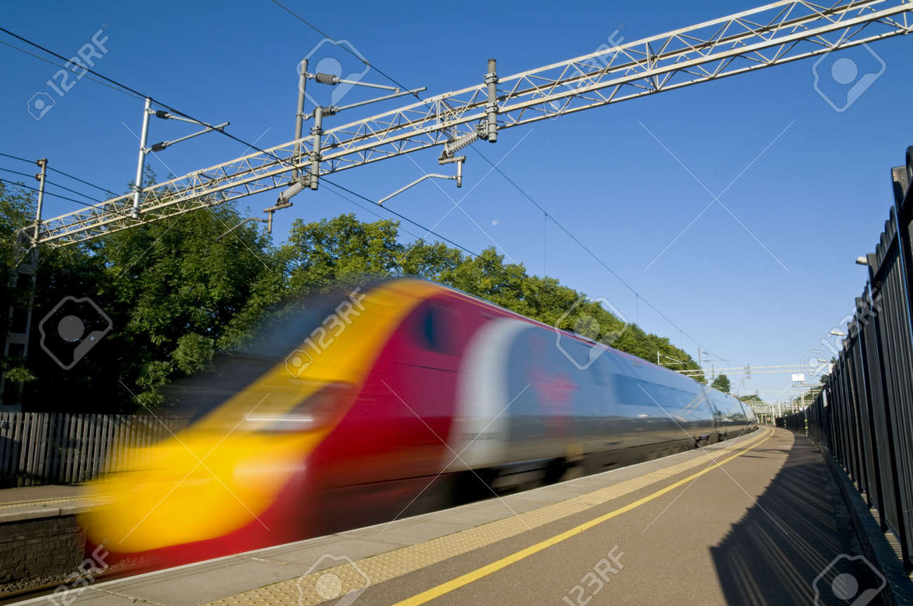 A British high speed passenger train passing through a station in the early morning. Stock Photo - 7746489