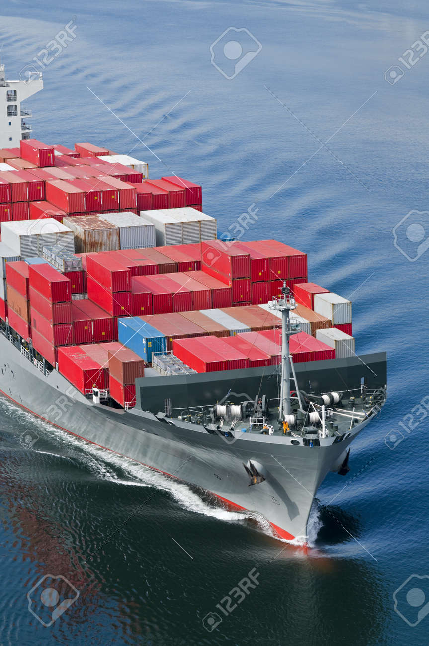 A container ship arriving in port on a very calm day. Stock Photo - 8944393