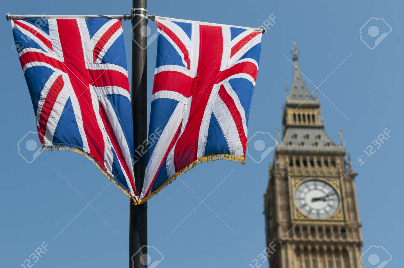 Two Union Flags flying in front of the clock tower, commonly referred to as Big Ben, of the Palace of Westminster. Stock Photo - 10441597