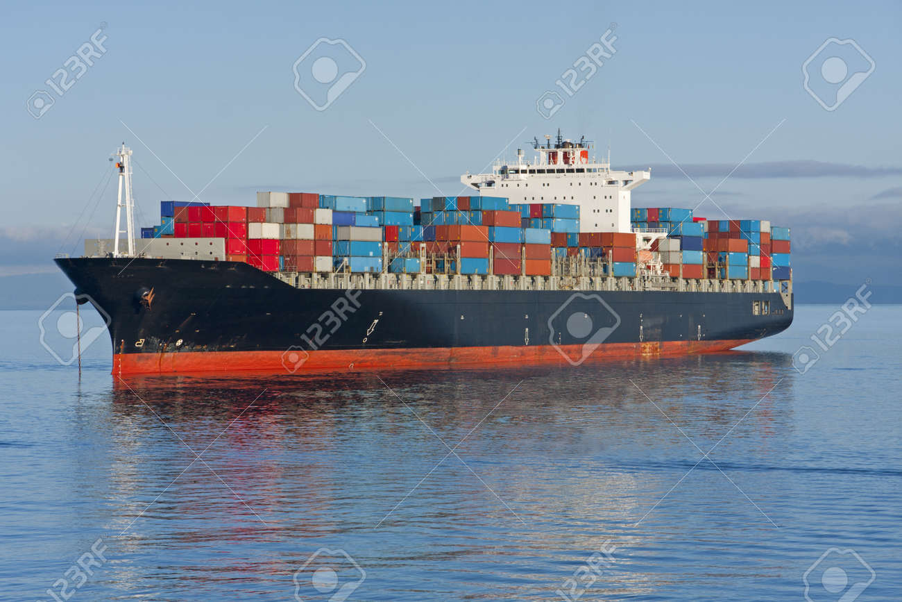 A container ship anchored in a harbour. Stock Photo - 13358460