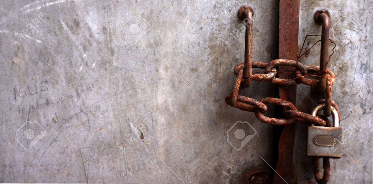 old padlock, latch and rusty gate coloured rick-red Stock Photo - 4649395