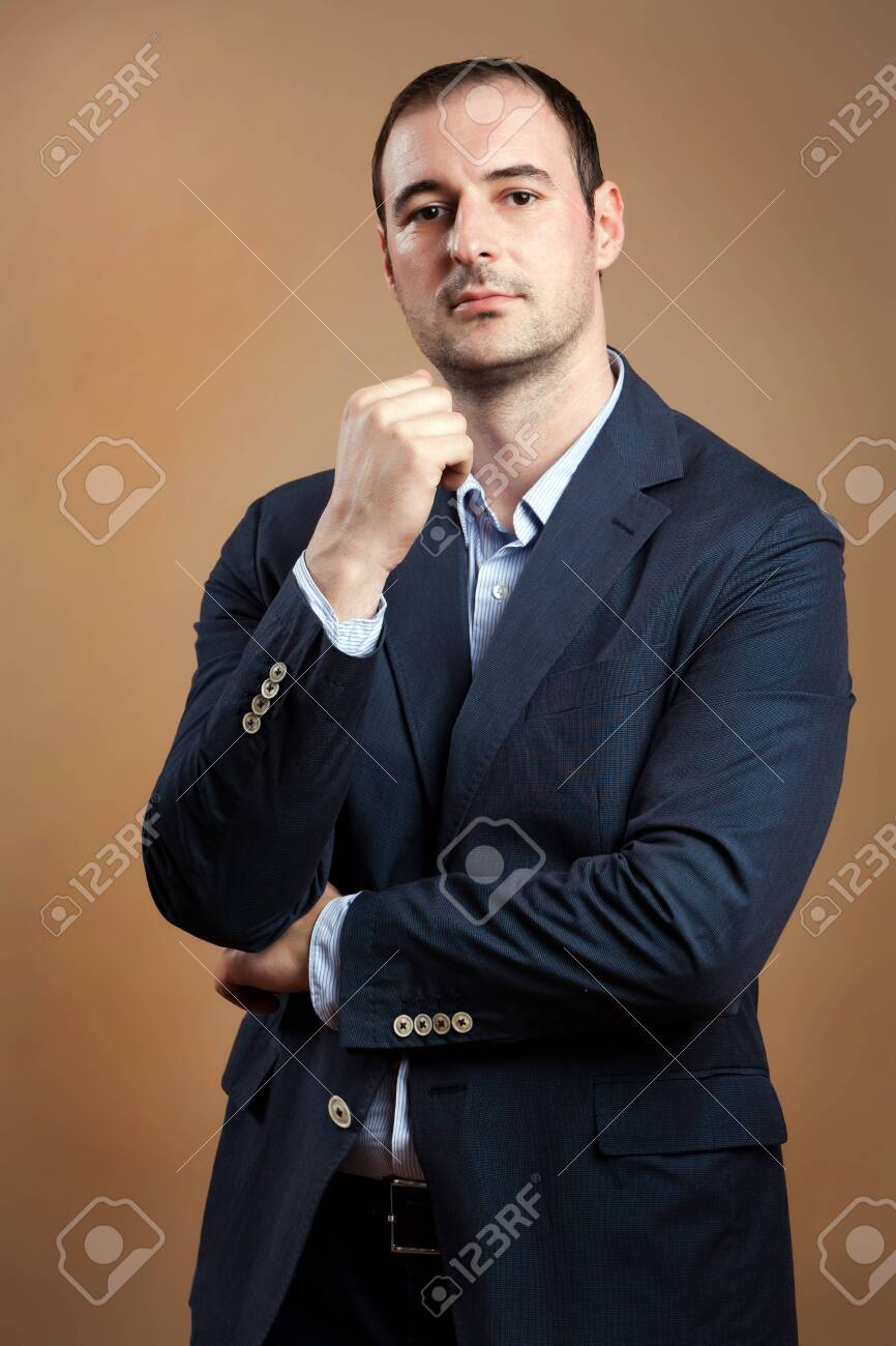 Businessman wearing suit in a relaxed position Stock Photo - 13829539