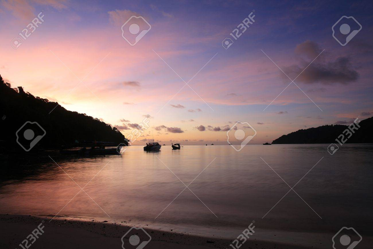 Travel background  silhouette scene of tropical beach before sunrise at Surin islands national park, Thailand Stock Photo - 12685965