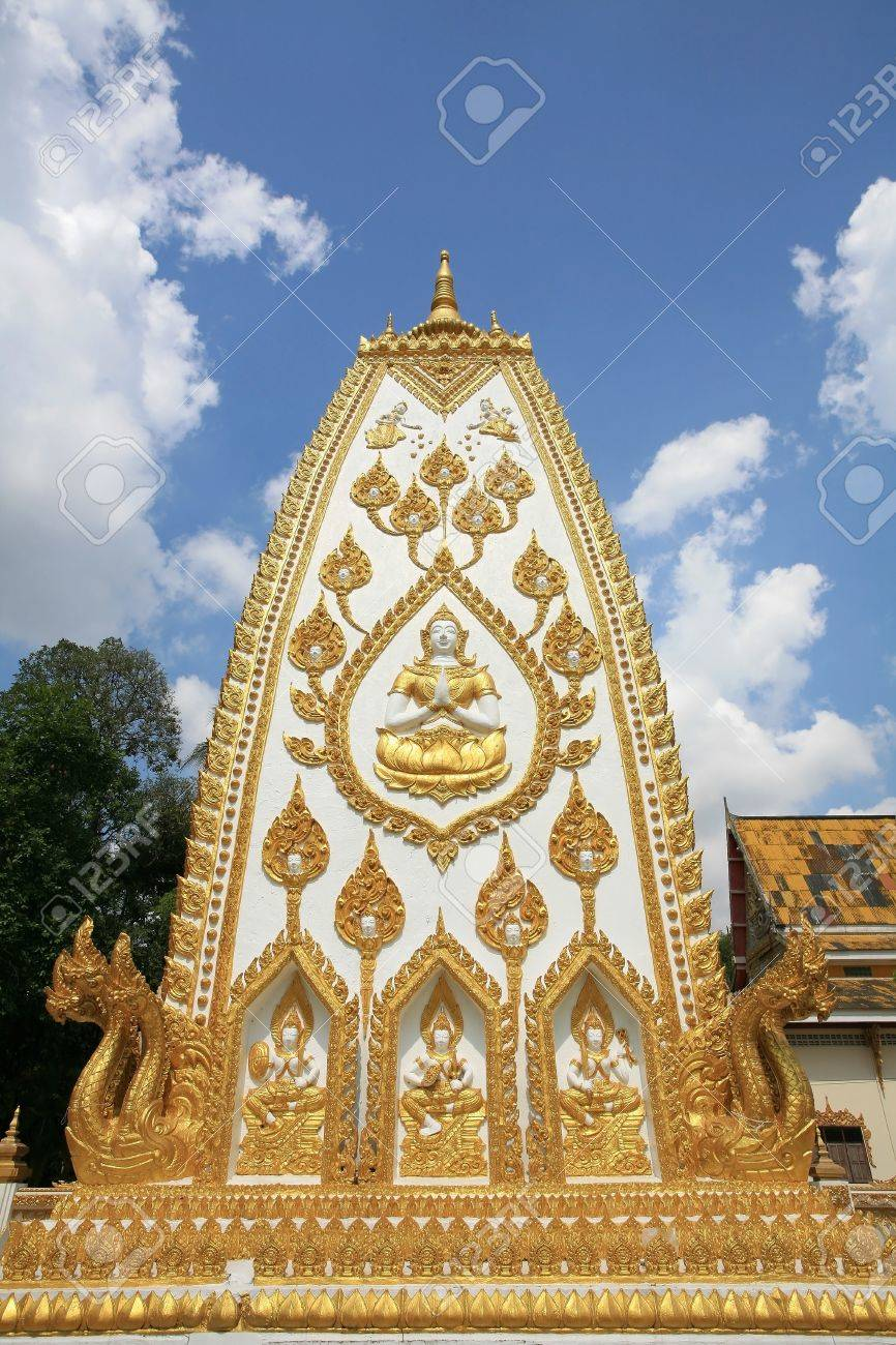 Ornament  god salute sculpture on white and gold pagoda surface against blue sky at wat Phrathat Nong Bua in Ubon Ratchathani province, Thailand Stock Photo - 13112474