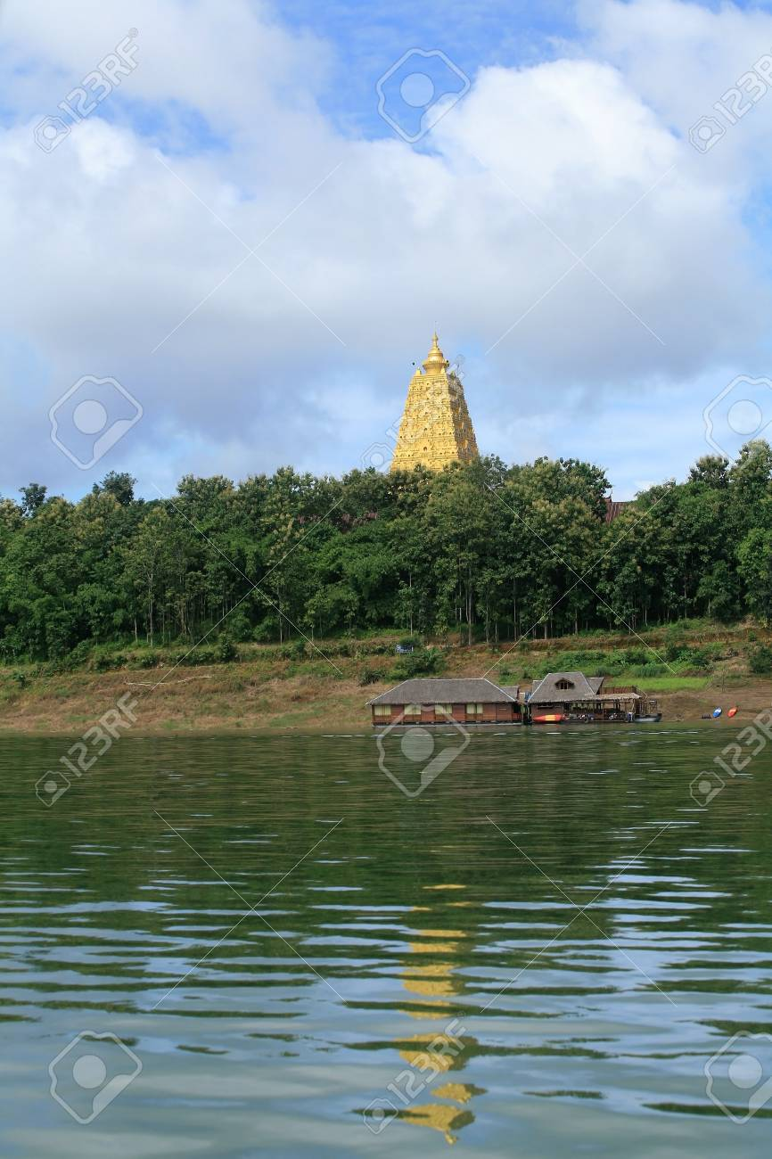Ornament  beautiful landscape of gold Buddhagaya pagoda and wooden raft house on the river at Sangklaburi, Thailand Stock Photo - 13112469