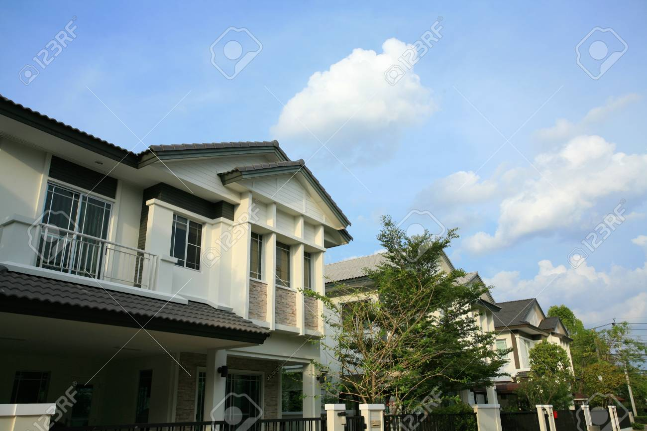 Closeup modern houses at second floor against blue sky Stock Photo - 13852127